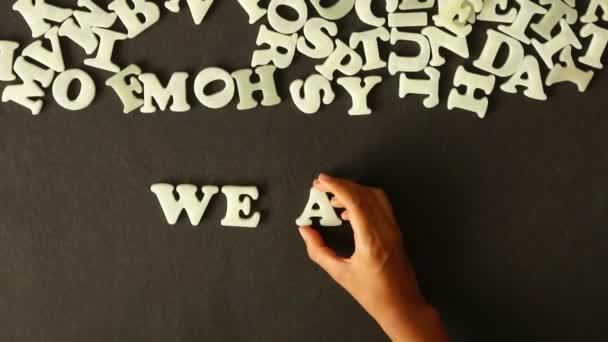 A person spelling we are moving