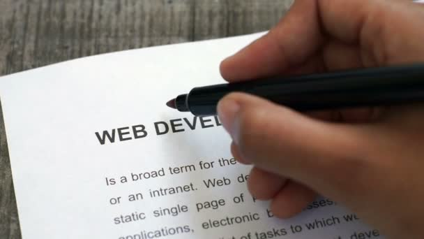 Circling Web Development with a red marker
