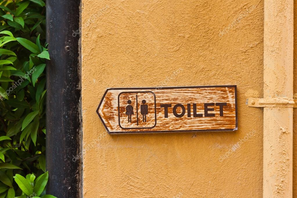 Ancient toilet sign