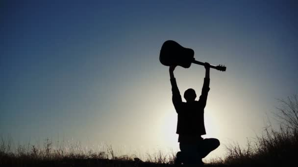 Male Figure Lifting Guitar Overhead