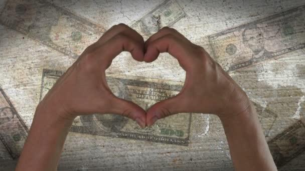 ruce se srdce symbolem peněz