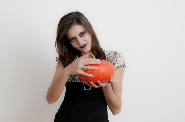 Gothic Woman with Halloween Pumpkin