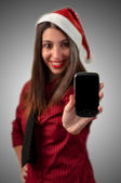 Fotografie smiling business christmas showing smartphone