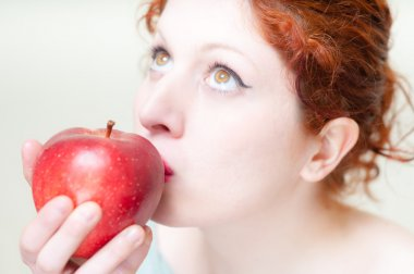 beautiful red hair and lips girl kissing apple
