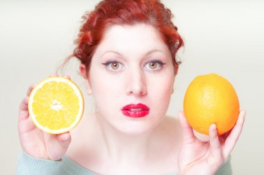 beautiful red hair and lips girl with oranges