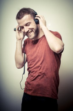vintage portrait of fashion smiling guy with headphones