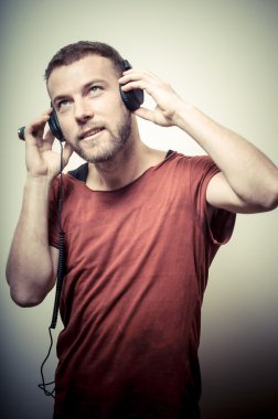 vintage portrait of fashion guy with headphones