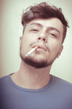 stylish young modern man with cigarette
