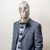 Photo businessman with gas mask