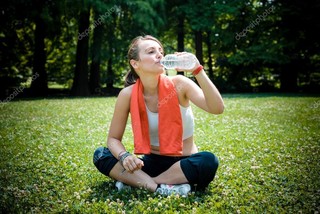 beautiful woman fitness drinking water