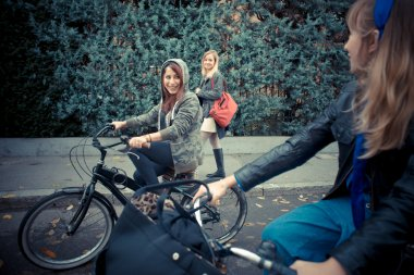 Three friends woman on bike