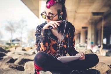 Punk dark girl using tablet