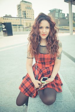 Curly  hipster woman  listening music