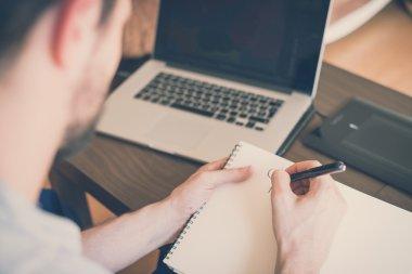 Man working home using laptop