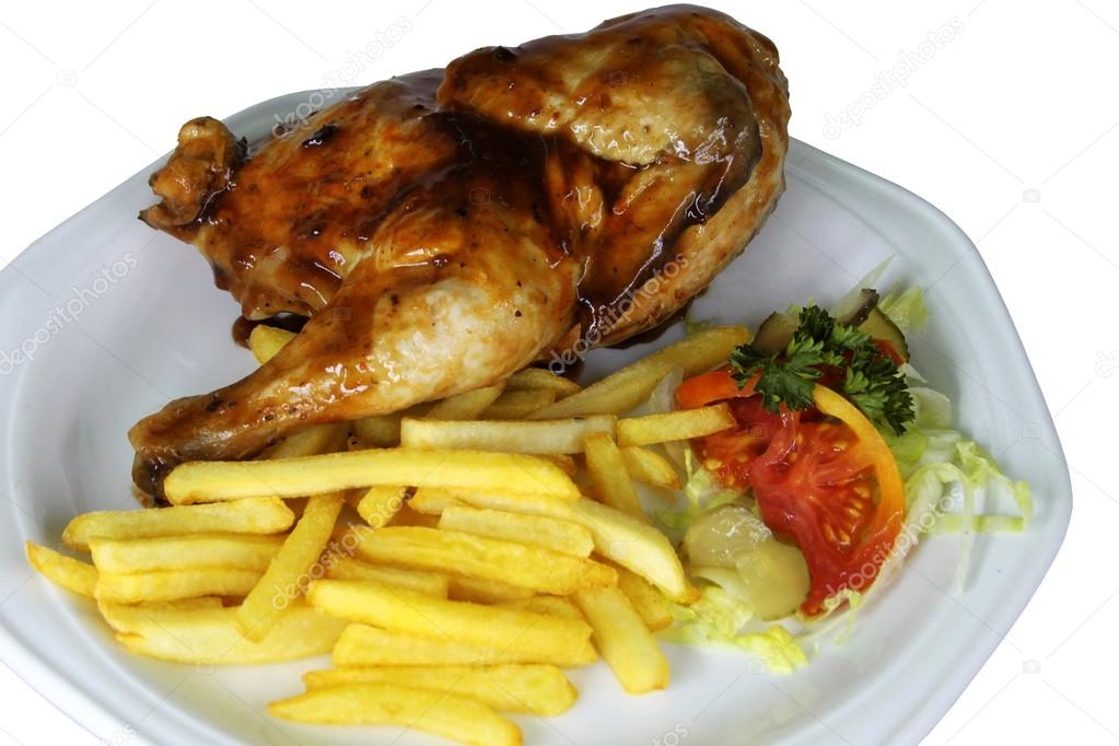 Isolated Half Chicken and Fries Close Up