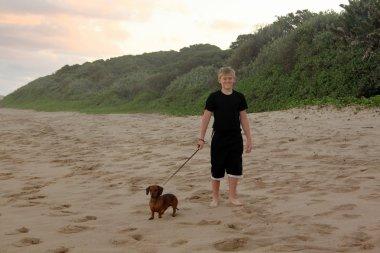 Boy Walking His Dogs on Beach