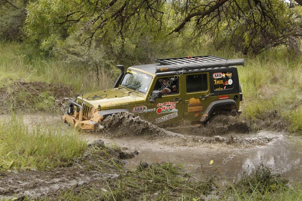 Gecko Pearl Green Jeep Wrangler Rubicon crossing muddy pond