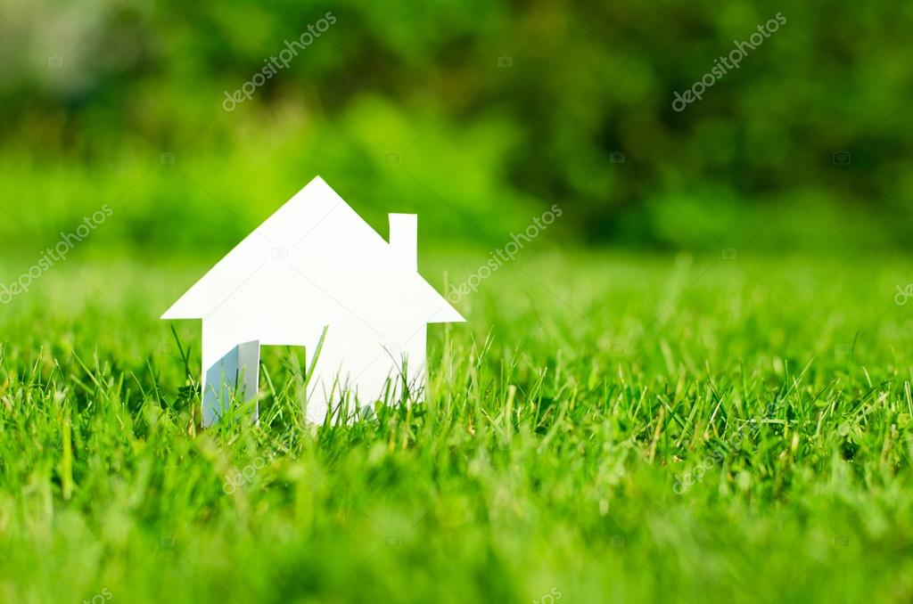 House in green field