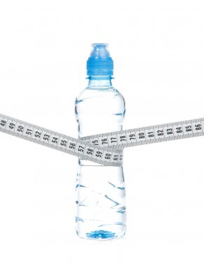 Diet bottle of drinking water and tape measure