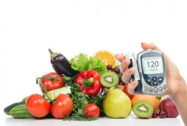 Diabetes concept glucose meter fruits and vegetables