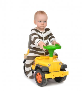 Infant child baby boy toddler happy driving big toy car truck