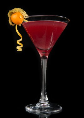 Red alcohol cosmopolitan cocktail on black background