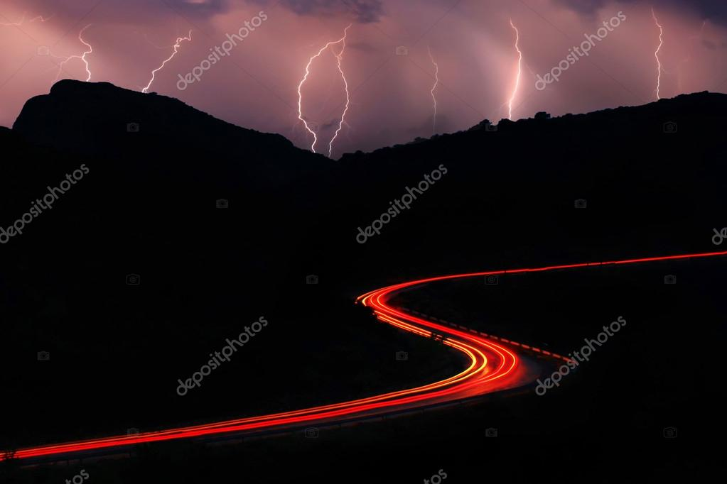 The road in the mountains during a thunderstorm