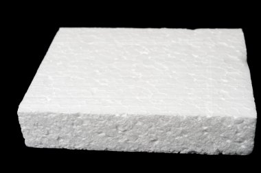 A piece of polystyrene foam isolated on black background stock vector