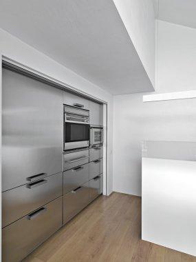 Modern kitchen with wood floor on garret