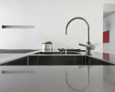 Detail of steel faucet in a modern kitchen