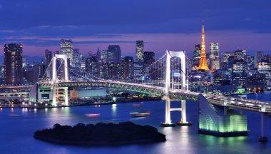Rainbow Bridge spanning Tokyo Bay with Tokyo Tower
