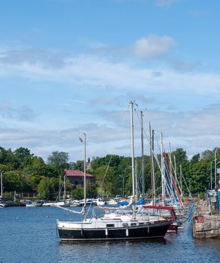 the yachts moored in the port on the quay