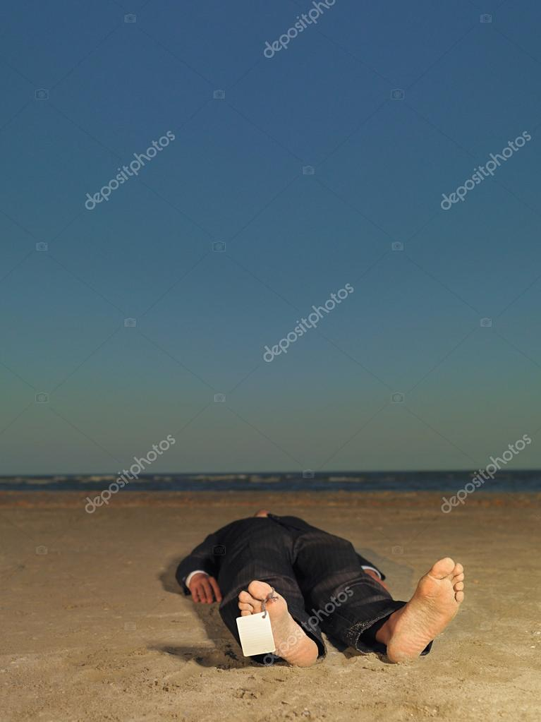 dead businessman with blank label on toe
