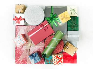 A pile of different shaped presents wrapped in shiny paper, with colorful bows, isolated on white background stock vector
