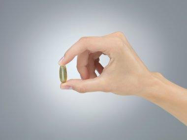 pill in fingers