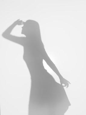woman silhouette seeking for something far away