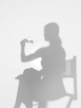 woman on director's chair, silhouette