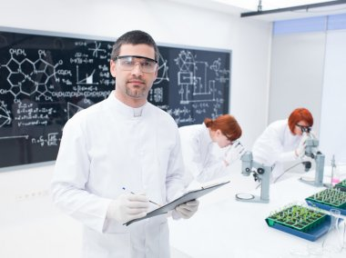 researchers working in a chemistry lab
