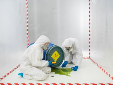 Checking a biohazard in a containment tent
