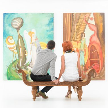 Couple talking about an artwork