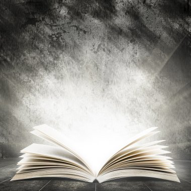 Old open book with magic light on a dark abstract background stock vector