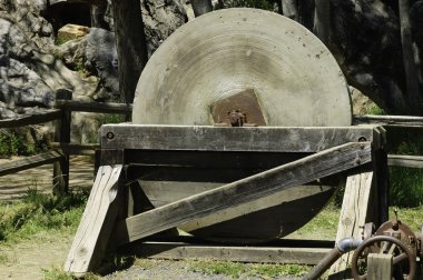 Antique millstone in western