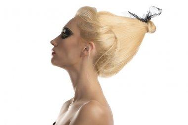 blonde girl with dark make-up in profile