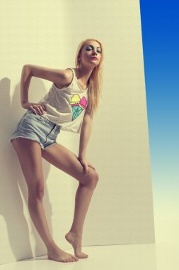 blonde girl with denim shorts in full lenght