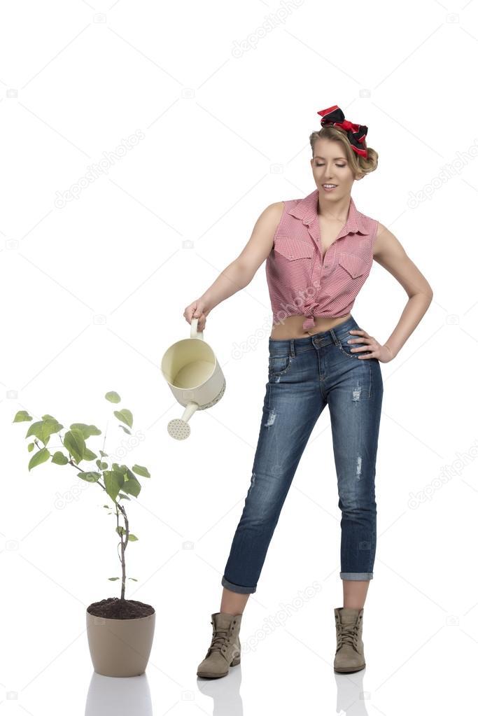 full-length portrait of female gardener