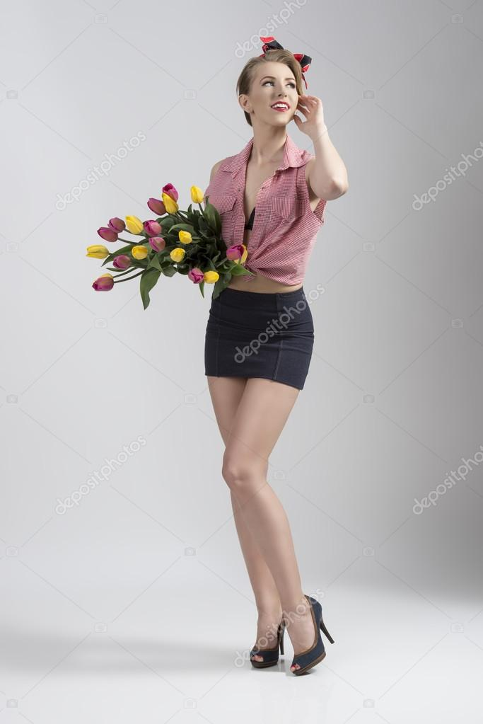sexy woman with bouquet of tulips