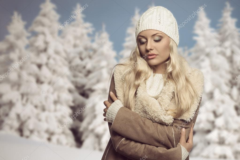 cold woman with winter clothes