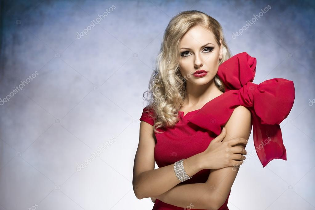 blond young girl in red with big bow