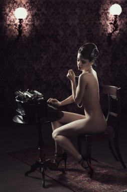old fashioned of nude woman typing