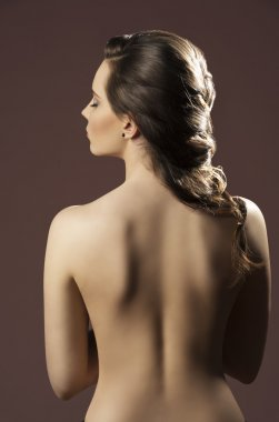 woman with bare back and hairdo